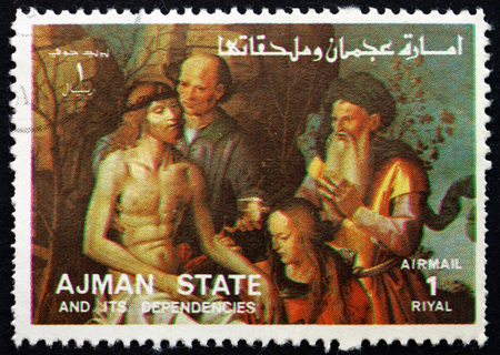 ajman: AJMAN - CIRCA 1973: a stamp printed in the Ajman shows The Descent from the Cross, Life of Jesus, circa 1973 Editorial