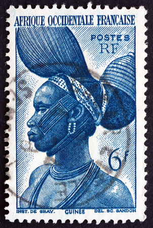 indigene: FRENCH WEST AFRICA - CIRCA 1947: a stamp printed in the France shows Fula Woman, French Guinea, circa 1947