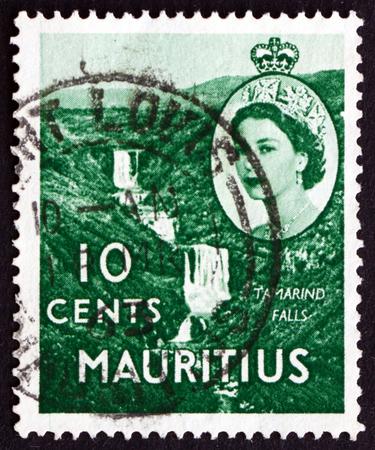 MAURITIUS - CIRCA 1953: a stamp printed in the Mauritius shows Tamarind Falls, circa 1953