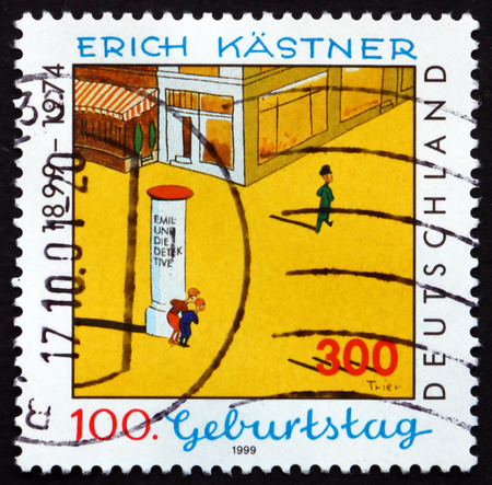 satirist: GERMANY - CIRCA 1999: a stamp printed in the Germany shows Scene from Book, Erich Kastner, Writer, circa 1999
