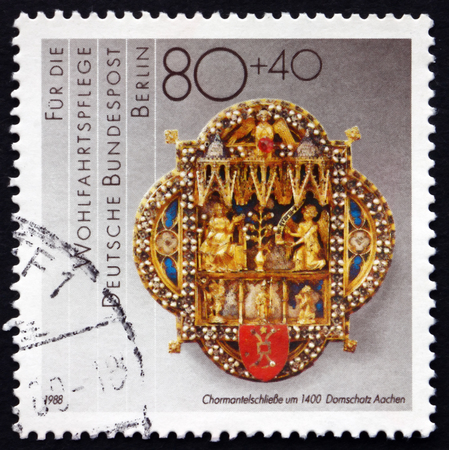 cope: GERMANY - CIRCA 1988: a stamp printed in the Germany, Berlin shows Cope Clasp, c. 1400, Aachen Cathedral, circa 1988