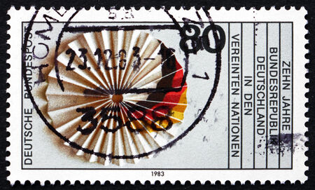 un used: GERMANY - CIRCA 1983: a stamp printed in the Germany shows German Flag, 10th Anniversary of UN Membership, circa 1983