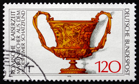 1st century ad: GERMANY - CIRCA 1976: a stamp printed in the Germany shows Roman Cup with Masks, 1st Century A.D., Archaeological Treasures, circa 1976 Editorial