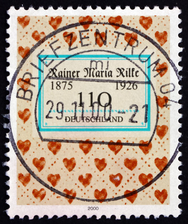 novelist: GERMANY - CIRCA 2000: a stamp printed in the Germany shows Rainer Maria Rilke, Bohemian-Austrian Poet and Novelist, Hearts, circa 2000 Editorial