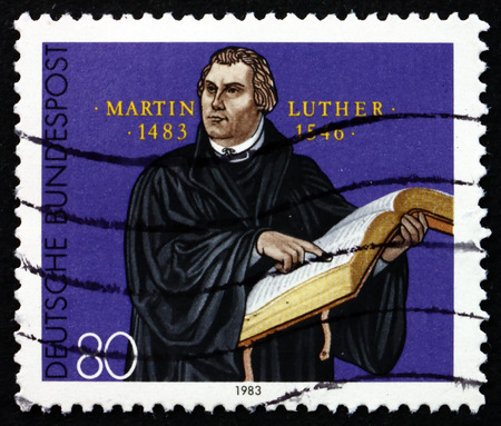 initiated: GERMANY - CIRCA 1983: a stamp printed in the Germany shows Martin Luther German Priest, who initiated the Protestant reformation, Engraving by G. Konig, circa 1983 Editorial