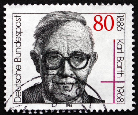 theologian: GERMANY - CIRCA 1986: a stamp printed in the Germany shows Karl Barth, Protestant Theologian, circa 1986