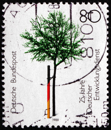 service tree: GERMANY - CIRCA 1988: a stamp printed in the Germany shows Tree, German Volunteer Service, 25th Anniversary, circa 1988