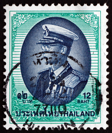 bhumibol: THAILAND - CIRCA 1999: a stamp printed in the Thailand shows King Bhumibol Adulyadej, Rama IX, King of Thailand, circa 1999