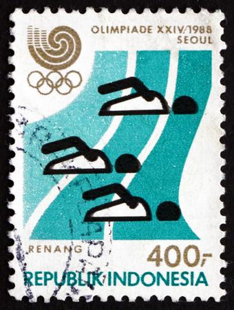 natation: INDONESIA - CIRCA 1988: un sello impreso en Indonesia muestra Nataci�n, Juegos Ol�mpicos de Verano 1988, Se�l, alrededor de 1988 Editorial