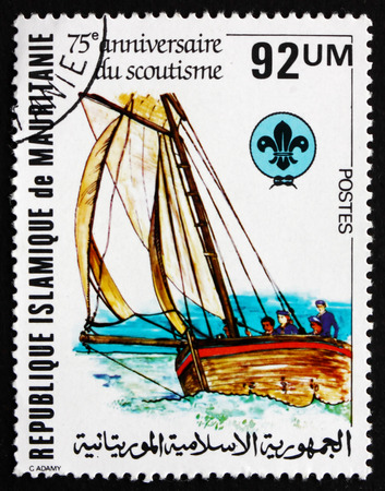 scouting: MAURITANIA - CIRCA 1982: a stamp printed in the Mauritania shows Boating Scene, Scouting Year, circa 1982