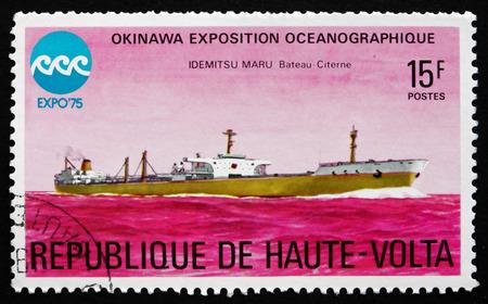 oceanographic: BURKINA FASO - CIRCA 1975: a stamp printed in Burkina Faso shows Idemitsu Maru, Tanker, Oceanographic Exposition, Okinawa, circa 1975