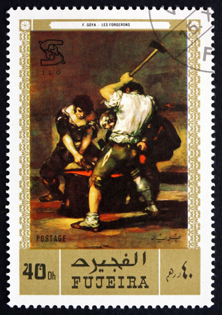 printmaker: FUJEIRA - CIRCA 1971: a stamp printed in the Fujeira shows The Forge, Painting by Francisco de Goya y Lucientes, Spanish Painter and Printmaker, circa 1971