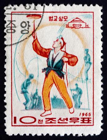 balancing act: NORTH KOREA - CIRCA 1965: a stamp printed in North Korea shows Balancing Act, Circus, Pyongyang, circa 1965