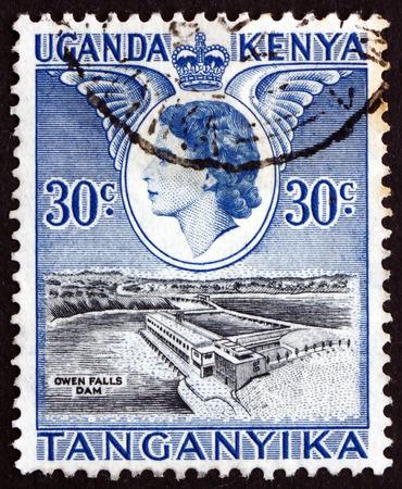 queen elizabeth ii: KENYA, UGANDA, TANZANIA - CIRCA 1954: a stamp printed in the Kenya, Uganda, Tanzania shows Owen Falls Dam, Visit of Queen Elizabeth II, circa 1954