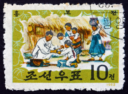 bu: NORTH KOREA - CIRCA 1963: a stamp printed in North Korea shows Saving a Swallow, Tale of Hung Bu, Korean Traditional Folktale, circa 1963