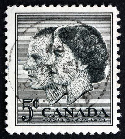 queen elizabeth ii: CANADA - CIRCA 1957: a stamp printed in the Canada shows Queen Elizabeth II and Prince Philip, Visit to Canada, circa 1957