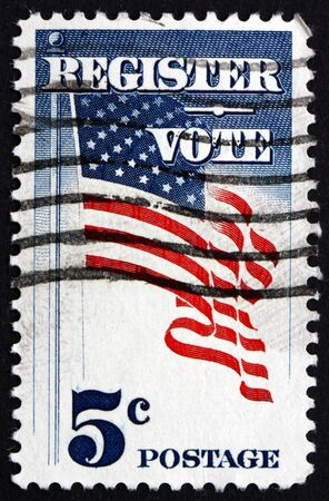 voters: UNITED STATES OF AMERICA - CIRCA 1964: a stamp printed in the United States of America shows US Flag, Register and Vote, Campaign to Draw More Voters to the Pools, circa 1964 Editorial