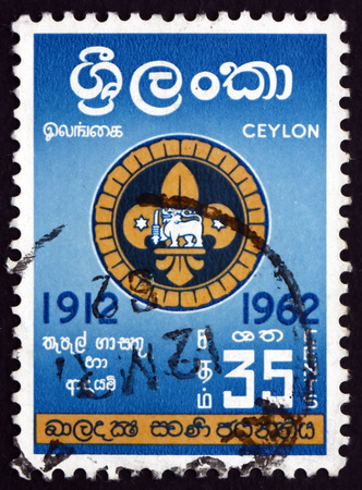 scouts: SRI LANKA - CIRCA 1962: a stamp printed in Sri Lanka shows Badge of Singhalese Scouts, Boy Scouts of Ceylon, 50th Anniversary, circa 1962