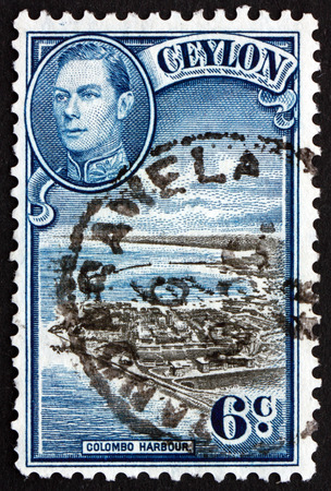 vi: SRI LANKA - CIRCA 1946: a stamp printed in Sri Lanka shows View of Colombo Harbour and Portrait of King George VI, circa 1946 Editorial