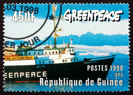 ship bow: GUINEA - CIRCA 1998: a stamp printed in the Guinea shows Bow of Greenpeace Ship, circa 1998