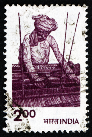 indian postal stamp: INDIA - CIRCA 1980: a stamp printed in India shows traditional Indian textile weaver, circa 1980 Editorial