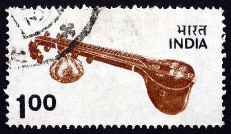 indian postal stamp: INDIA - CIRCA 1974: a stamp printed in India shows Veena, plucket stringed instrument originating in ancient India, used mainly in Indian and Pakistani classical music, circa 1974 Editorial