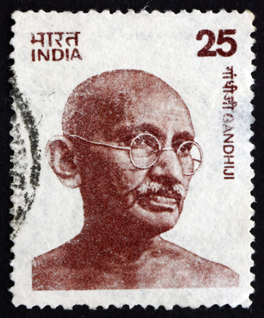 ruled: INDIA - CIRCA 1979: a stamp printed in India shows Mahatma Gandhi, portrait, leader of Indian independence movement in British-ruled India, circa 1979 Editorial