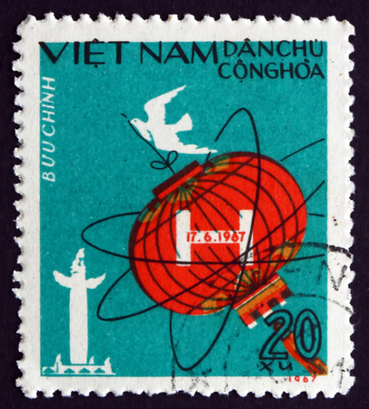 hydrogen bomb: VIETNAM - CIRCA 1967: a stamp printed in Vietnam shows Chinese Lantern, Atomic Symbol and Dove, 1st Chinese Hydrogen Bomb Test, circa 1967