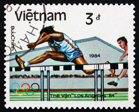 summer olympics: VIETNAM - CIRCA 1983: a stamp printed in Vietnam shows Hurdles, 1984 Summer Olympics, Los Angeles, circa 1983 Editorial