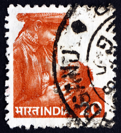 indian postal stamp: INDIA - CIRCA 1981: a stamp printed in India shows Mother Feeding Child, circa 1981