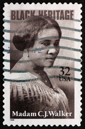 philanthropist: USA - CIRCA 1998: a stamp printed in the USA shows Madam C. J. Walker, Entrepreneur, Philanthropist, and the First Female, self-made Millionaire in America, Black Heritage, circa 1998
