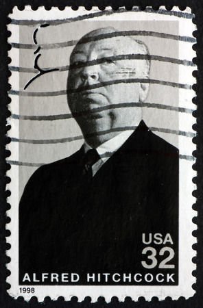 film director: USA - CIRCA 1998: a stamp printed in the USA shows Sir Alfred Hitchcock, English Film Director and Producer, circa 1998