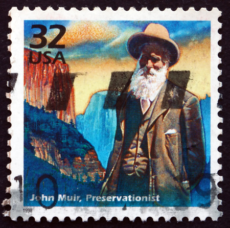 conservationist: USA - CIRCA 1998: a stamp printed in the USA shows John Muir, American naturalist and conservationist, circa 1998