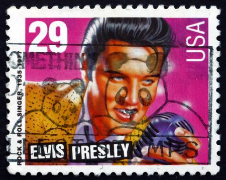 elvis presley: USA - CIRCA 1993: a stamp printed in the USA shows Elvis Presley, American Singer and Actor, the King of Rock and Roll, circa 1993