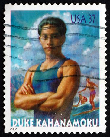 lawman: USA - CIRCA 2002: a stamp printed in the USA shows Duke Kahanamoku and Surfers at Waikiki Beach, circa 2002 Editorial