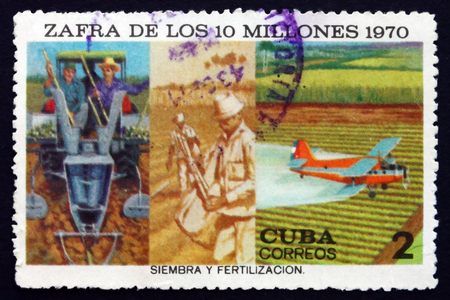 projected: CUBA - CIRCA 1970: a stamp printed in the Cuba shows Sowing and Crop Dusting, Projected Production, circa 1970