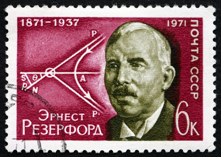 physicist: RUSSIA - CIRCA 1971: a stamp printed in the Russia shows Ernest Rutherford, British Physicist, Diagram of Movement of Atomic Particles, circa 1971