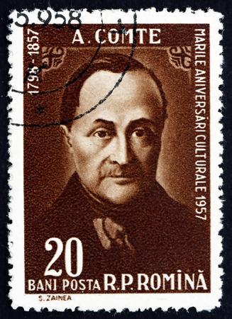 sociologia: RUMANIA - CIRCA 1958: un sello impreso en Rumania muestra Auguste Comte, filósofo francés, fundador de la disciplina de la sociología, alrededor de 1958 Editorial