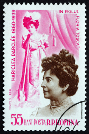 the soprano: ROMANIA - CIRCA 1964: a stamp printed in the Romania shows Hariclea Darclee as Tosca, Romanian Operatic Soprano, circa 1964