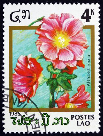 alcea: LAOS - CIRCA 1986: un sello impreso en Laos muestra Malva, Alcea Rosea, Planta Ornamental, alrededor del a�o 1986