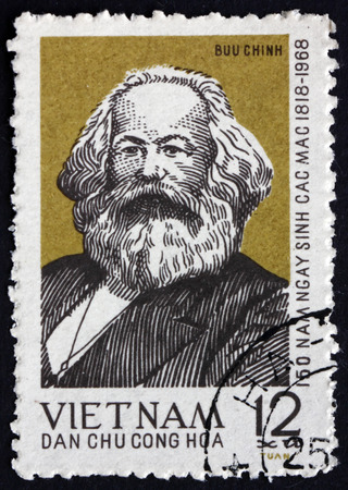 sociologist: VIETNAM - CIRCA 1968: a stamp printed in Vietnam shows Karl Marx, Philosopher, Economist and Revolutionary Socialist, circa 1968