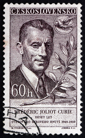 physicist: CZECHOSLOVAKIA - CIRCA 1959: a stamp printed in the Czechoslovakia shows Frederic Joliot Curie, French Physicist, Nobel Laureate, circa 1959 Editorial