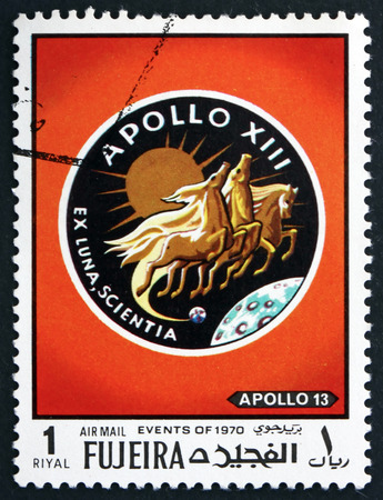 fujeira: FUJEIRA - CIRCA 1970: a stamp printed in the Fujeira shows Emblem, Apollo 13, Mission to the Moon, circa 1970 Editorial