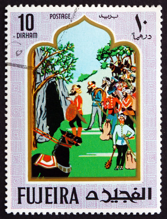 forty: FUJEIRA - CIRCA 1967: a stamp printed in the Fujeira shows Scene from the Fairy Tale Ali Baba and the Forty Thieves, circa 1967