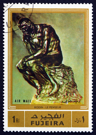the thinker: FUJEIRA - CIRCA 1972: a stamp printed in the Fujeira shows The Thinker, Sculpture by Auguste Rodin, French Sculptor, circa 1972