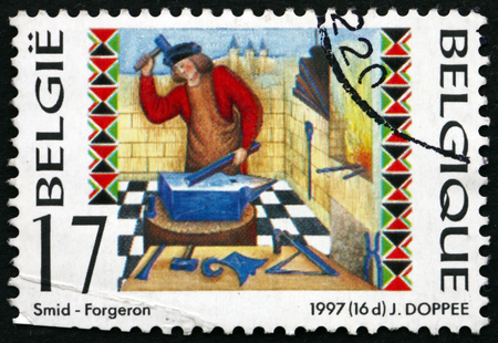 forger: BELGIUM - CIRCA 1997: a stamp printed in the Belgium shows Blacksmith, is a Craftsman who Creates, Objects from Wrought Iron or Steel by Forging the Metal, circa 1997