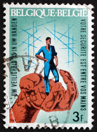 guarding: BELGIUM - CIRCA 1968: a stamp printed in the Belgium shows Hand Guarding Worker, Industrial Safety, circa 1968