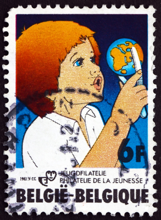 philately: BELGIUM - CIRCA 1981: a stamp printed in the Belgium shows Child with Globe, Youth Philately, circa 1981