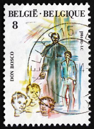 sacerdote: B�lgica - alrededor de 1984: un sello impreso en la muestra B�lgica San Juan Bosco canonizaci�n, fue un sacerdote cat�lico italiano Romano, alrededor de 1984