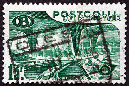 sorting: BELGIUM - CIRCA 1950: a stamp printed in the Belgium shows Sorting Mail, circa 1950